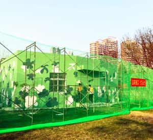 天津滨海新区公园墙体彩绘,公园外墙墙画,迷彩手绘墙,融入自然的绿色墙画->